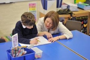 Teaching Assistants worth with students, giving much needed support to teachers.